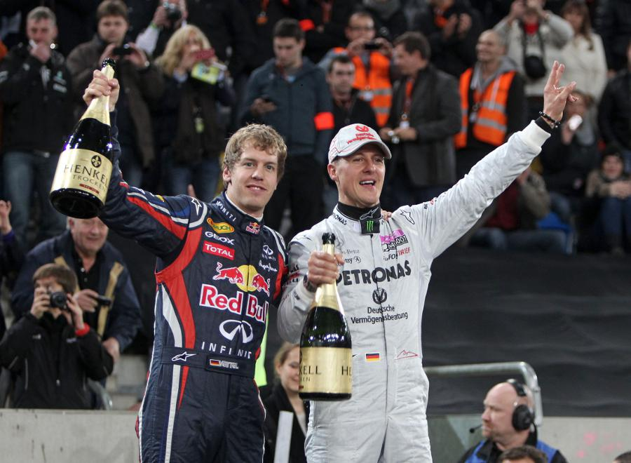 Sebastian Vettel and Michael Schumacher celebrate their victory for Team Germany in the Nations Cup