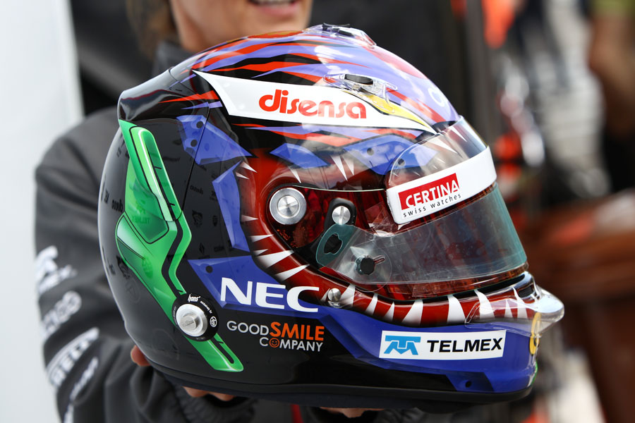 Kamui Kobayashi shows off his special helmet for the weekend, designed by Linkin Park's Chester Bennington