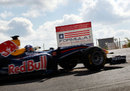 David Coulthard drives his Red Bull through the gates of the Circuit of the Americas