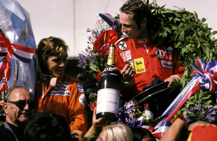 Niki Lauda and James Hunt celebrate on the podium after the race