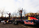 Mark Webber and Sebastian Vettel wave to their fans