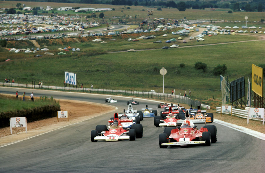 Niki Lauda leads James Hunt on the formation lap