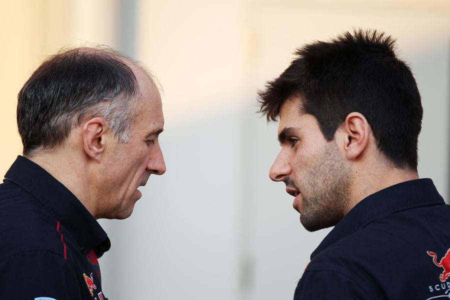 Franz Tost in discussion with Jaime Alguersuari in the paddock
