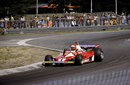 Niki Lauda threads his way through the final chicane