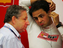 Jean Todt talks to Felipe Massa at the back of the garage