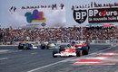 James Hunt leads Clay Regazzoni in front of a packed crowd