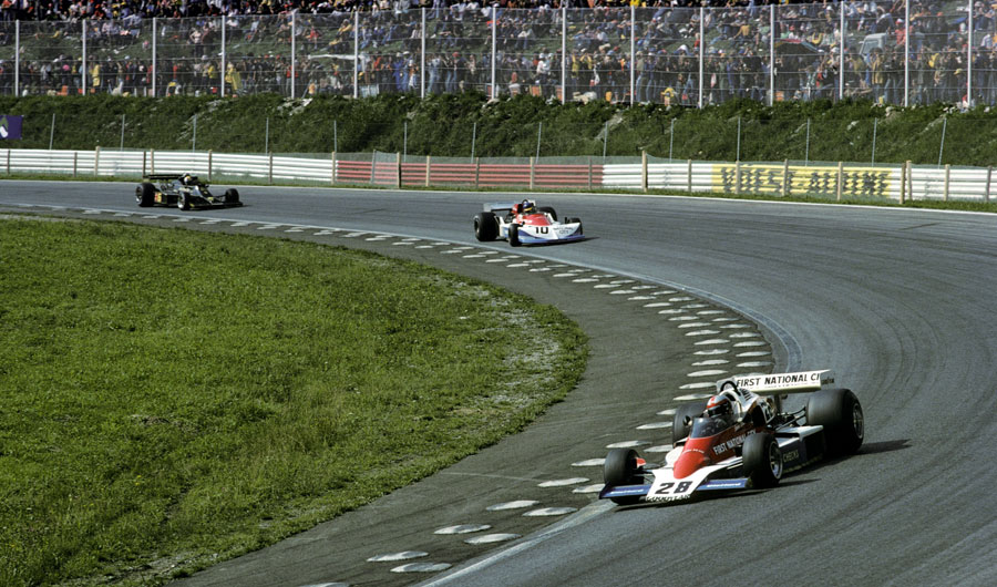 John Watson leads Ronnie Peterson and Gunnar Nilsson as he exits the final corner
