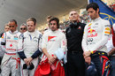 The drivers and team principals observe a minute's silence in memory of Dan Wheldon and Marco Simoncelli