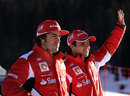 Fernando Alonso and Felipe Massa salute some fans at Ferrari's annual media event Wrooom