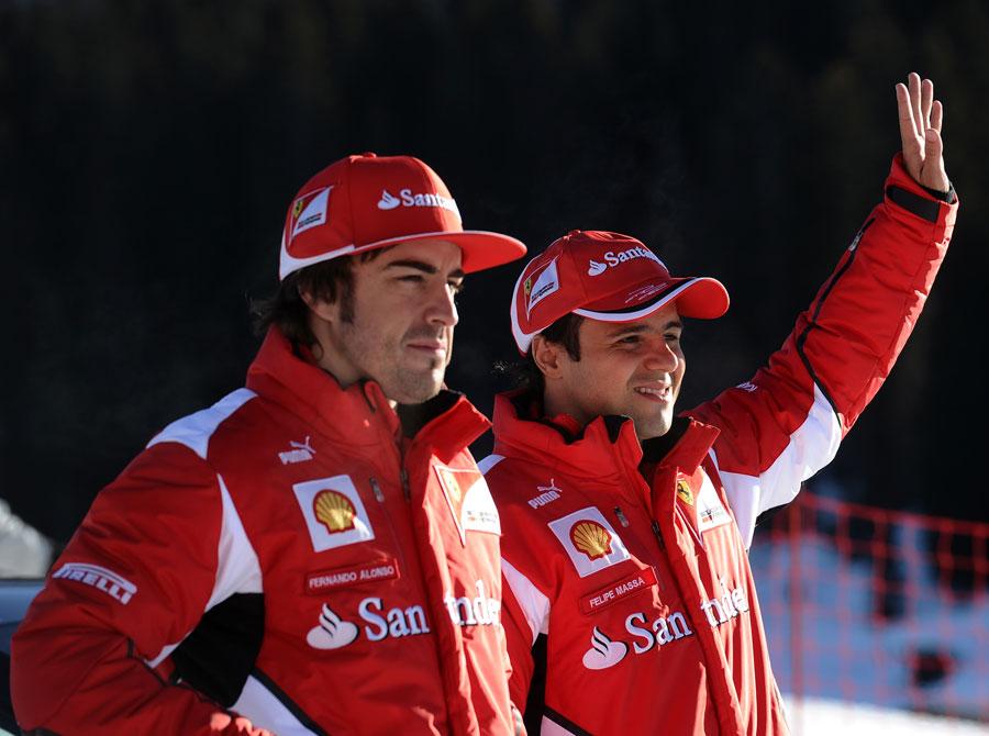 Fernando Alonso and Felipe Massa salute some fans at Ferrari's annual media event Wrooom