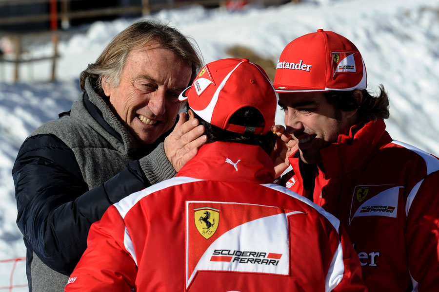 Luca di Montezemolo embraces Felipe Massa during Ferrari's annual media event Wrooom