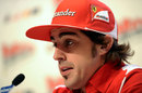 Fernando Alonso answers questions in a press conference at Ferrari's annual media event Wrooom