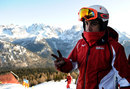 Fernando Alonso waves before going skiing at Ferrari's annual media event Wrooom
