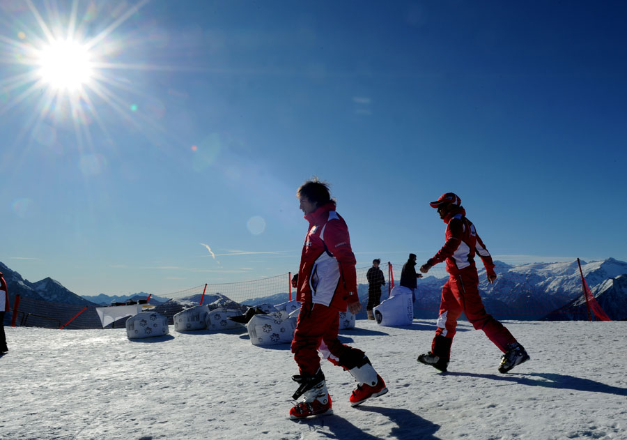 Felipe Massa and Fernando Alonso march across a mountain during Ferrari's annual media event Wrooom