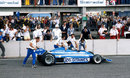 Jacques Laffite is congratulated by his Ligier team after taking victory