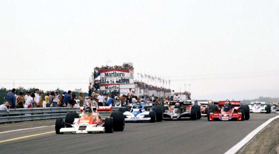 James Hunt leads away from Jacques Laffite at the start of the race with Mario Andretti and John Watson side-by-side behind