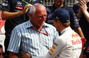 Red Bull owner Dietrich Mateschitz congratulates Sebastian Vettel on his victory