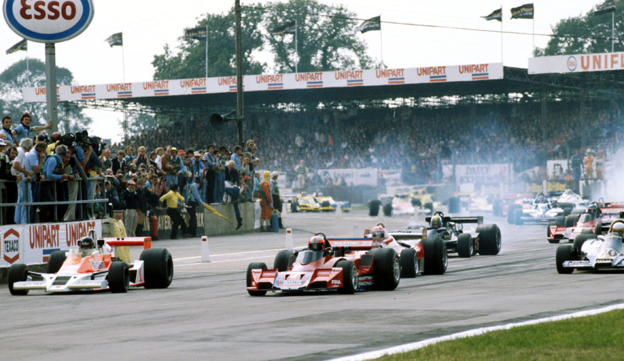 Pole-sitter James Hunt suffers a poor start and is beaten off the line by John Watson