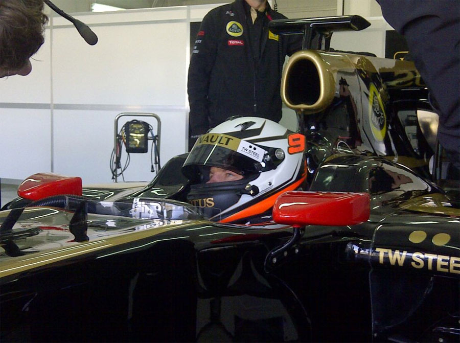 Kimi Raikkonen waits in the garage during a private test for Lotus
