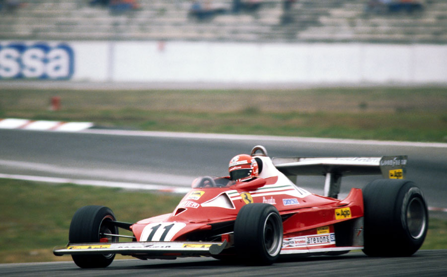 Niki Lauda gets the power down in his Ferrari
