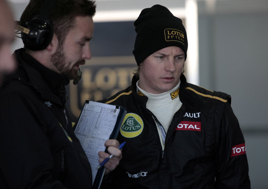 Kimi Raikkonen listens to his engineers in the Lotus garage