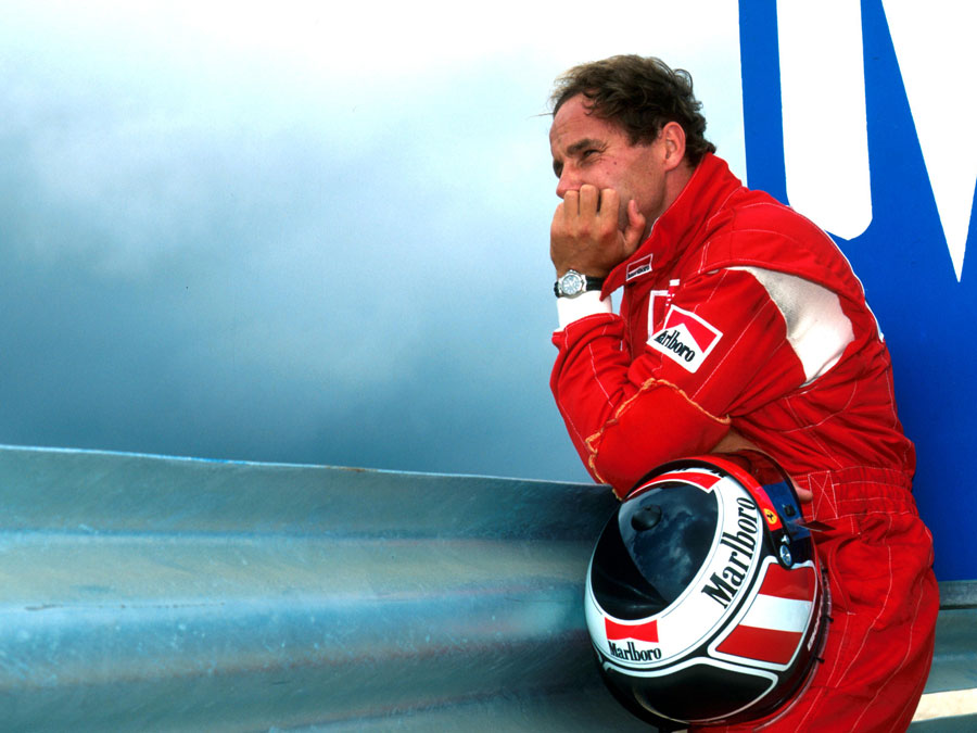 Gerhard Berger watches on after retiring from the lead with transmission failure