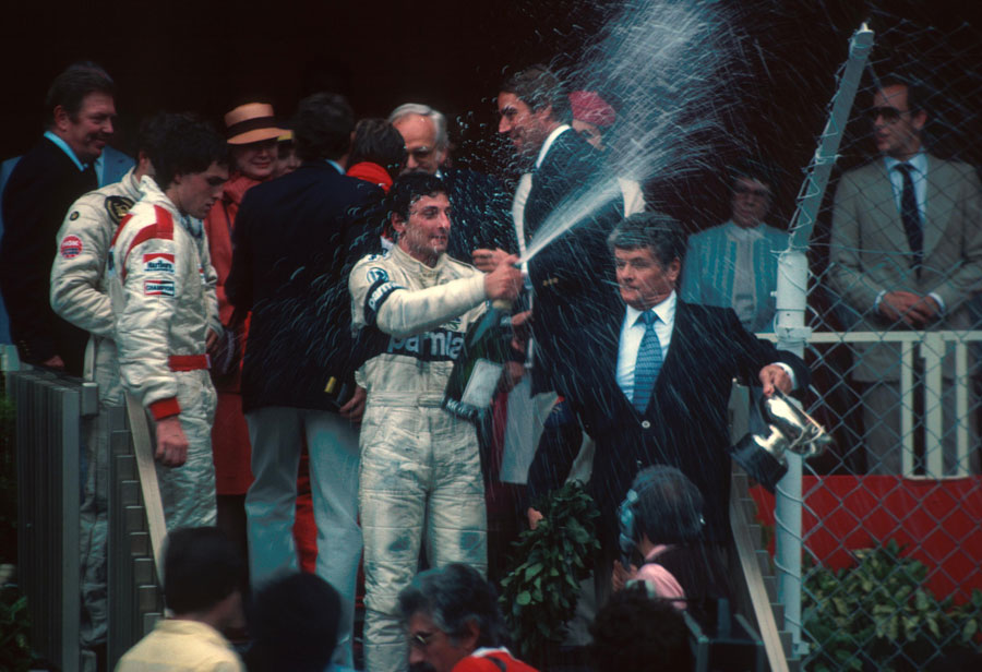 Riccardo Patrese celebrates his first grand prix victory on the podium