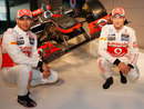 Lewis Hamilton and Jenson Button pose with the new McLaren MP4-27