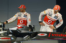 Lewis Hamilton and Jenson Button inspect the new car