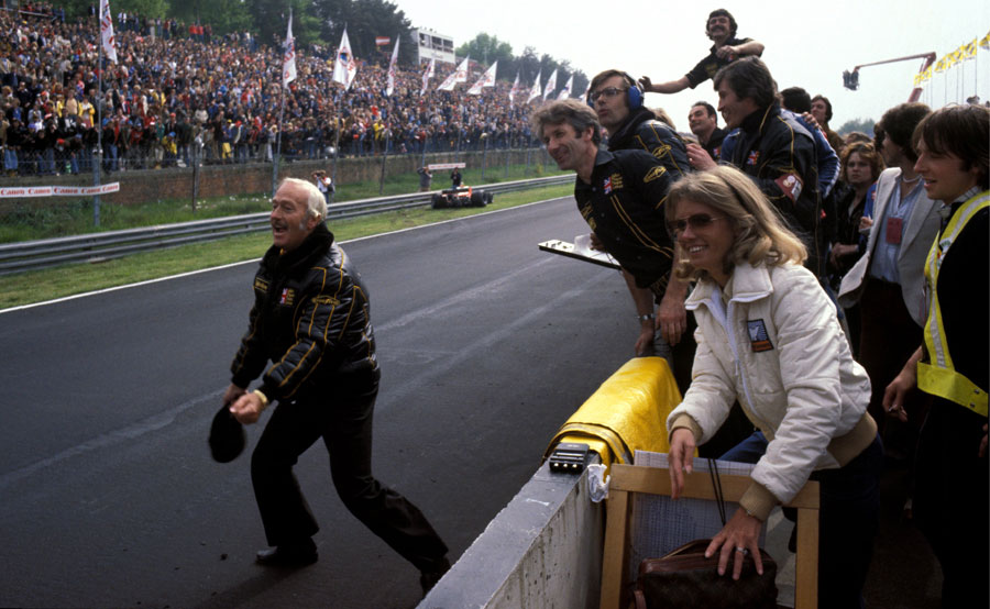 Colin Chapman prepares to celebrate victory in his customary style