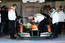 Paul di Resta is strapped in before taking to the track in the Force India VJM05