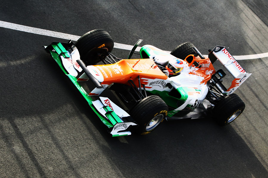 Paul di Resta leaves the pit lane in the Force India VJM05