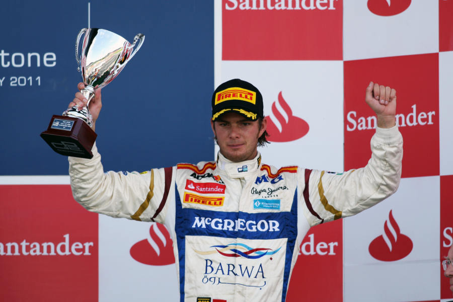 Giedo van der Garde celebrates his third place on the podium at Silverstone
