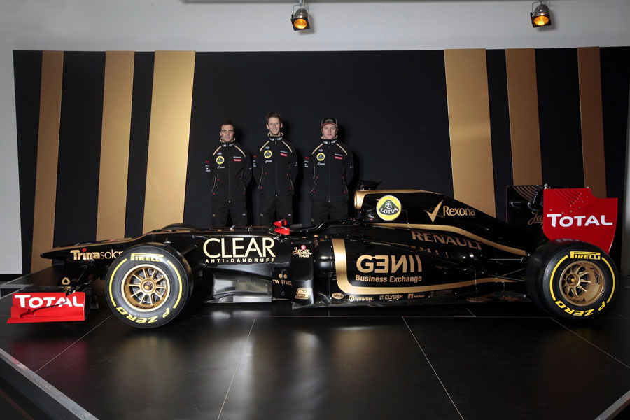 Jerome d'Ambrosio, Romain Grosjean and Kimi Raikkonen pose with the new Lotus E20