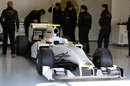 HRT's 2011 car - the F111 - in the garage in Jerez