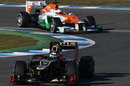 Kimi Raikkonen is closley shadowed by Paul di Resta