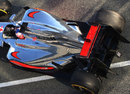 Jenson Button leaves the garage in the McLaren MP4-27 with exhaust channels
