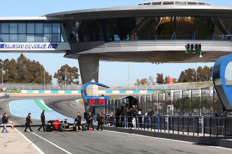 Kimi Raikkonen is wheeled back in to the garage