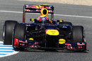 Mark Webber clips the apex in the RB8