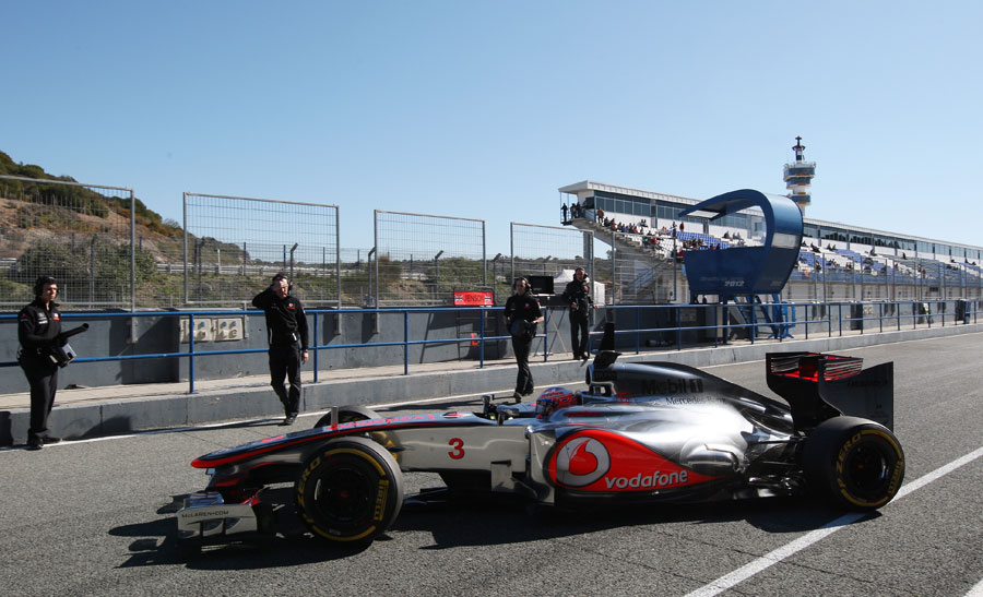 Jenson Button pulls up outside the McLaren garage