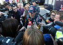 Mark Webber talks to the press following his first run in the Red Bull RB8
