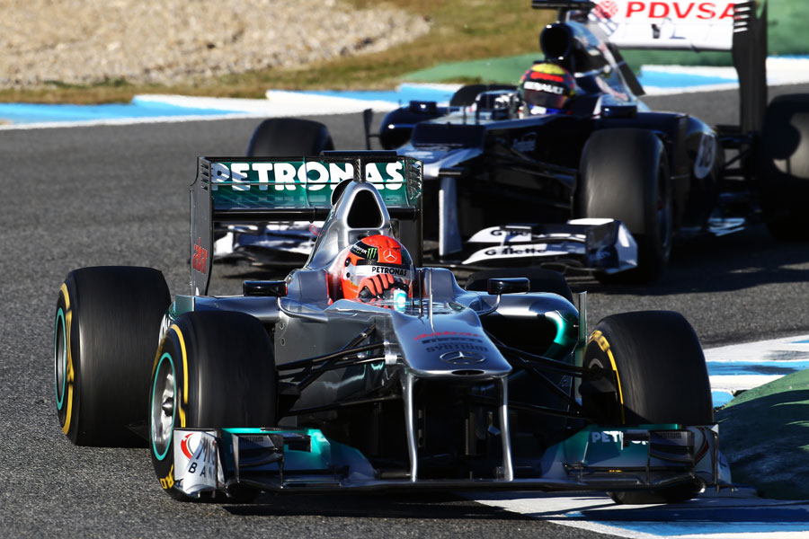 Michael Schumacher leads Pastor Maldonado through the chicane
