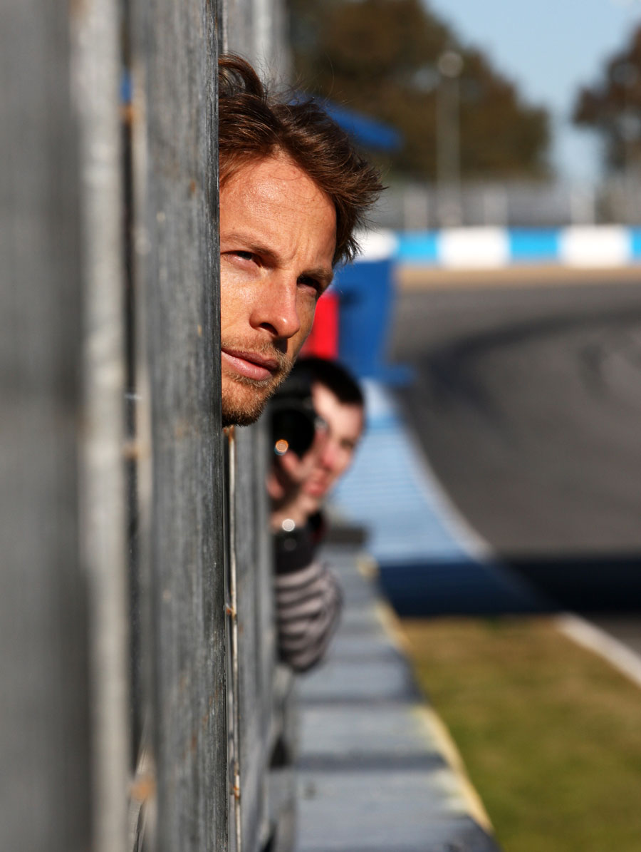 Jenson Button takes time to observe the other cars on track