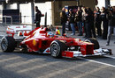 Fernando Alonso returns to the pits after his first run in the Ferrari F2012