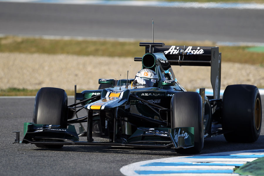 Giedo van der Garde clips the apex in the Caterham