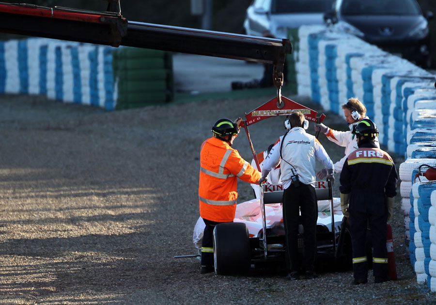 Force India's VJM05 is recovered from the barriers after Jules Bianchi went off on Thursday morning