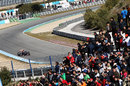 Jean-Eric Vergne attacks the circuit as the fans search for a glimpse of Fernando Alonso