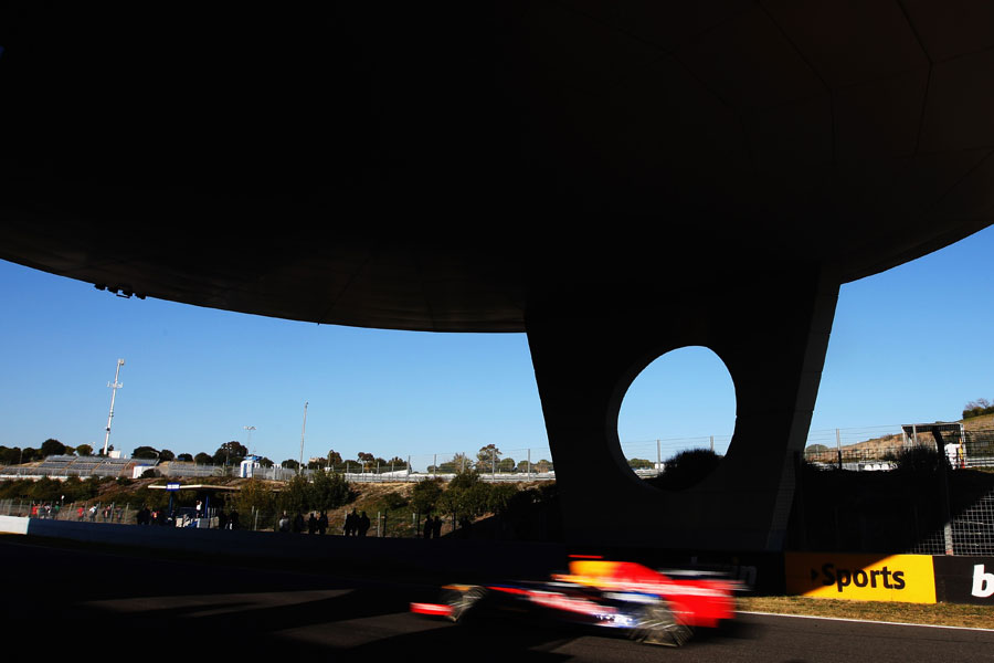 Sebastian Vettel speeds under the media centre at Jerez