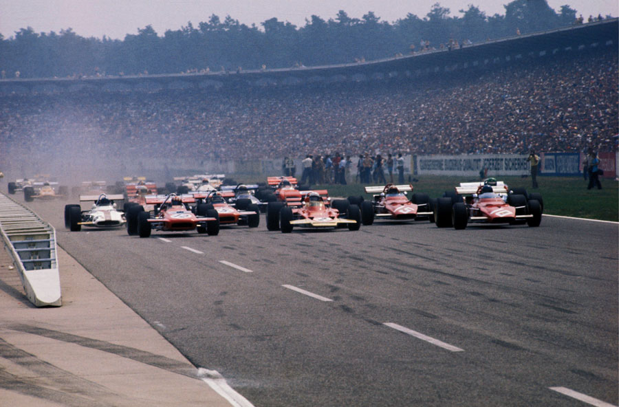 Jochen Rindt and Jacky Ickx lead the pack away from the grid
