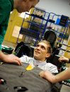 Vitaly Petrov carries out a seat fitting at Caterham